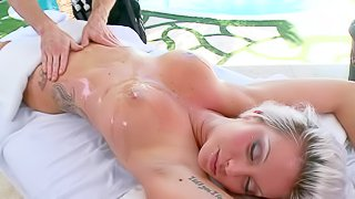 Deadra Dee is an extremely sexy blonde with perfect body that loves full body rub down. Naked sexy ass goddess gets her huge boobs rubbed and her shaved innie pussy fingered before masseur finds his cock in her hot mouth