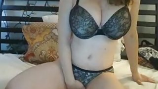 Big tits covered with festive lights on lingerie girl