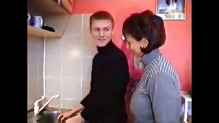 Russian mom Amalia with her boy in kitchen