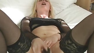 Hot as hell mom in stockings and heels masturbates