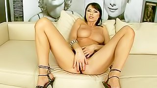 Attractive black haired beauty with big jaw dropping hooters and long legs in high heels teases her boyfriend in point of view and starts fingering shaved wet cunny to warm orgasm
