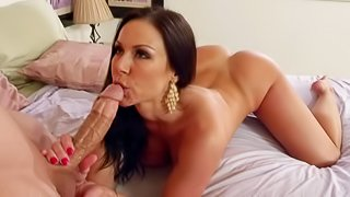 He finds his buddys mom Kendra Lust sleeping in the bedroom. Lovely pantyless woman attracts his attention. He takes pictures of her bare bubble ass and then pulls out his cock. Busty milf doesnt mind having sex with hot boy after waking up